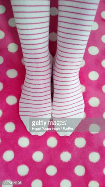 low section of woman standing on carpet - millennial pink stock pictures, royalty-free photos & images