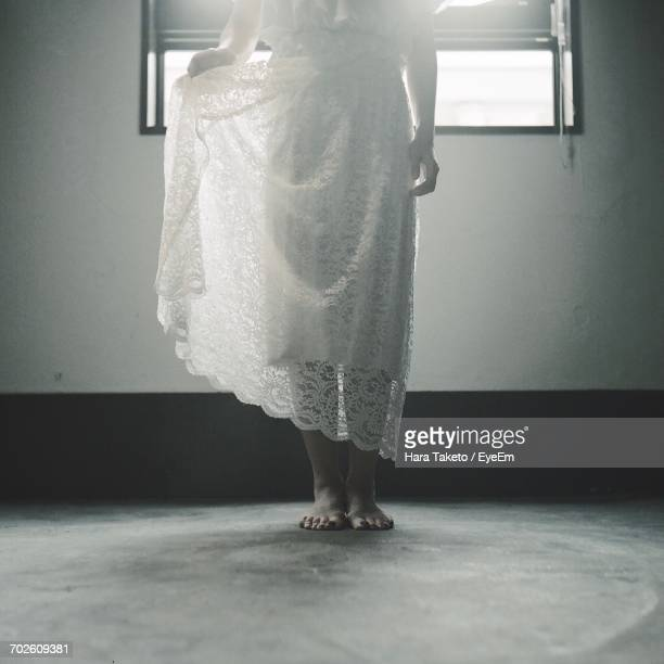 Low Section Of Woman Standing On Floor