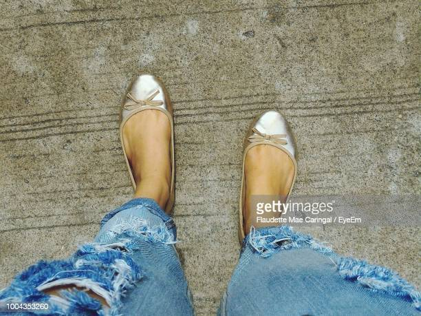 low section of woman standing on footpath - trail of tears stock photos and pictures