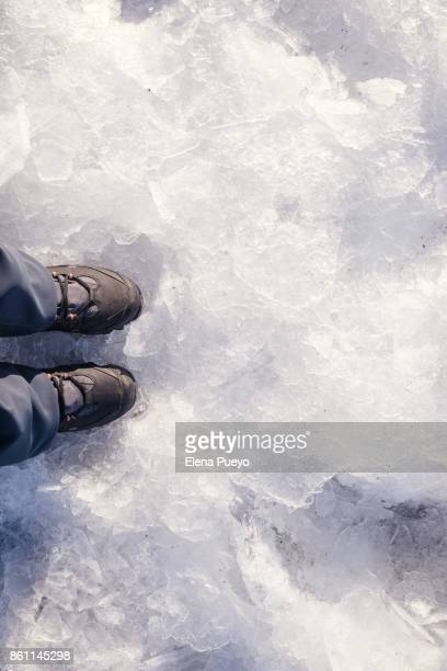 Low Section Of Woman Standing on ice