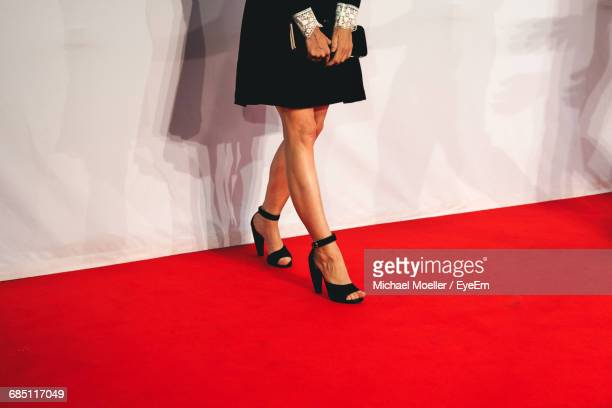 low section of woman standing on red carpet - red carpet event stock pictures, royalty-free photos & images