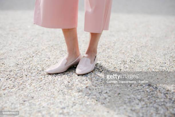 low section of woman standing on road - pink pants stock pictures, royalty-free photos & images