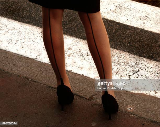 low section of woman standing on street - talons aiguilles photos et images de collection