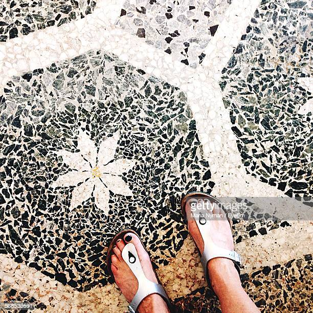 Low Section Of Woman Standing On Terrazzo Flooring