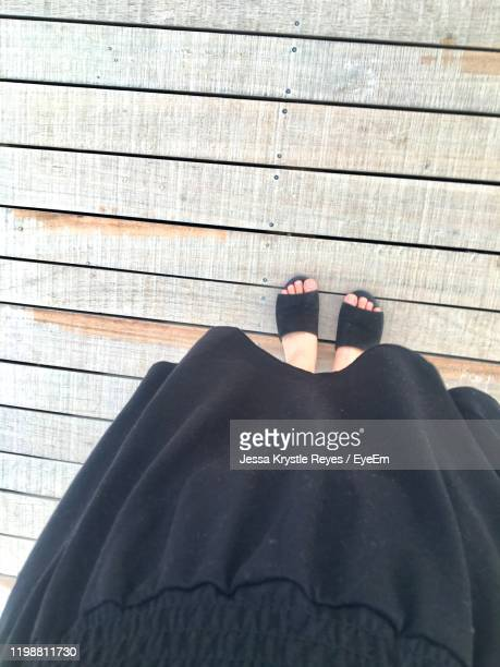 low section of woman standing on wooden floor - jessa stock pictures, royalty-free photos & images