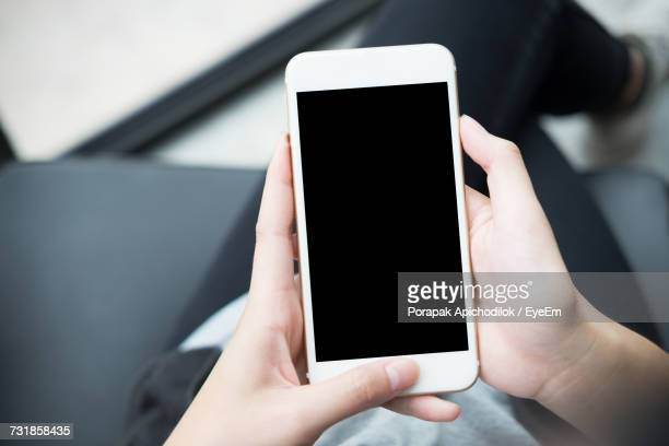 Low Section Of Woman Using Phone