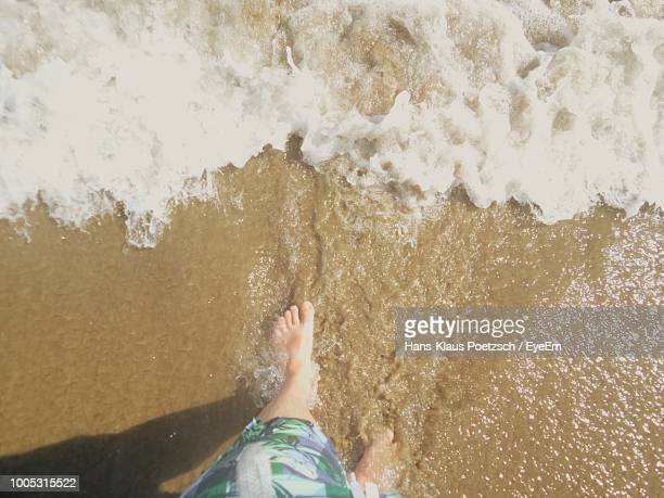 low section of woman walking in sea - belek stock pictures, royalty-free photos & images
