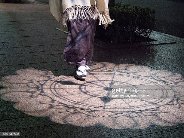 low section of woman walking in shopping mall - ginza stock pictures, royalty-free photos & images