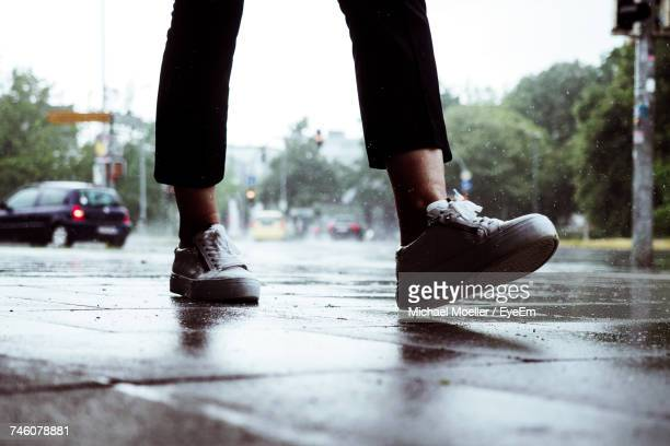 Low Section Of Woman Walking In Street