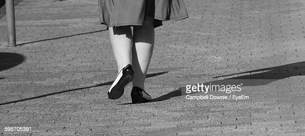 low section of woman walking on cobblestone street - campbell downie stock pictures, royalty-free photos & images