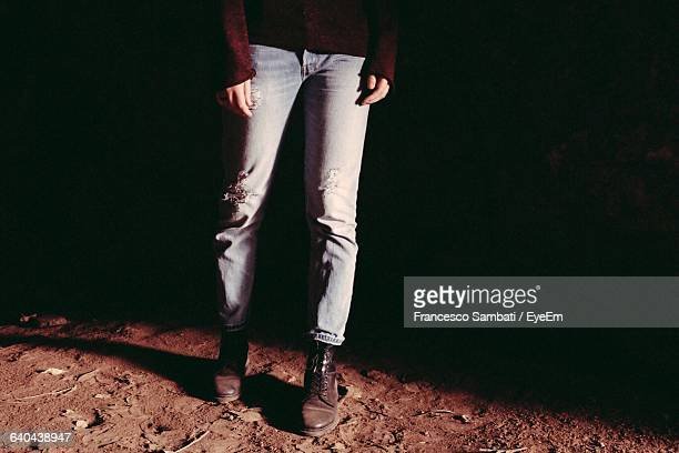 Low Section Of Woman Walking On Dirt Footpath