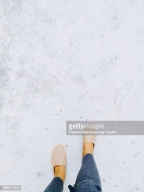 low section of woman walking on footpath - low section stock pictures, royalty-free photos & images