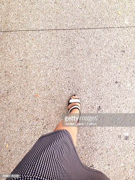 low section of woman walking on pavement - low section stock pictures, royalty-free photos & images