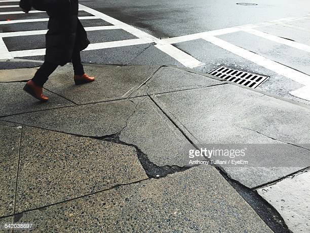 low section of woman walking on sidewalk by street - low section stock pictures, royalty-free photos & images