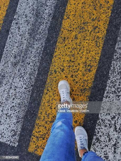low section of woman walking on zebra crossing - low section stock pictures, royalty-free photos & images