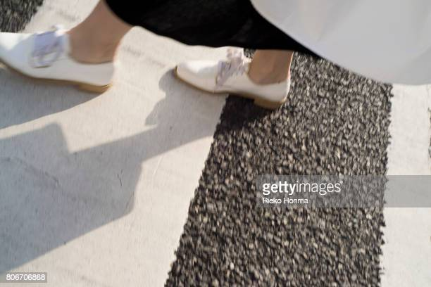 low section of woman walking on zebra crossing - asian women feet stock pictures, royalty-free photos & images