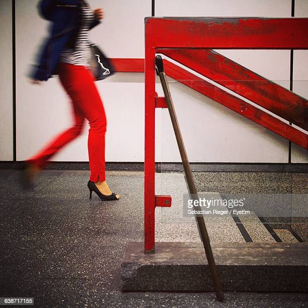 Low Section Of Woman Walking Towards Staircase