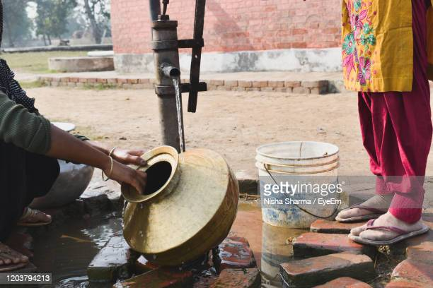 low section of woman washing water pot - scarce stock pictures, royalty-free photos & images