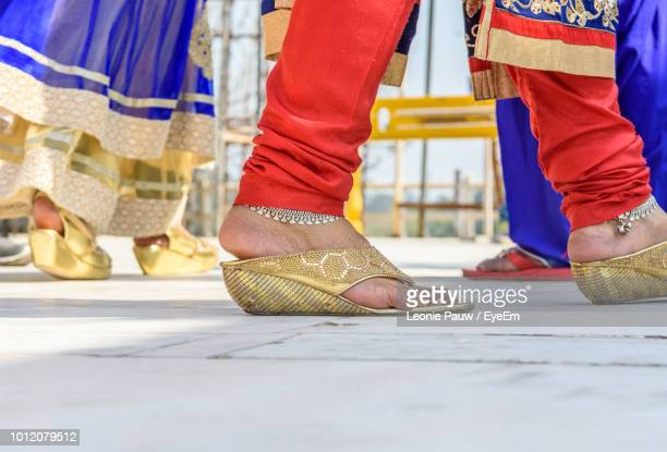 low section of woman wearing anklets - indian female feet stock pictures, royalty-free photos & images