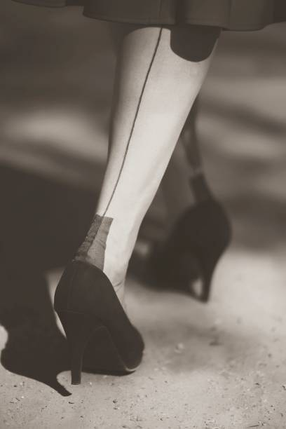 Low Section Of Woman Wearing High Heels Standing Outdoors