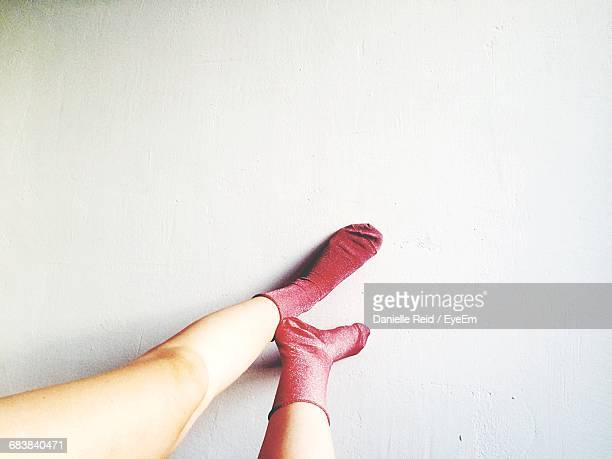 low section of woman wearing pink socks - pink sock image stock pictures, royalty-free photos & images