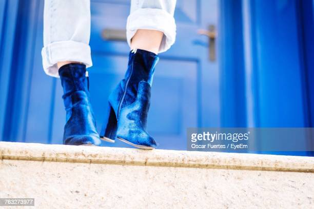 low section of woman wearing shoes - blue shoe stock pictures, royalty-free photos & images