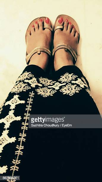 low section of woman wearing slippers - japanese women feet stock photos and pictures