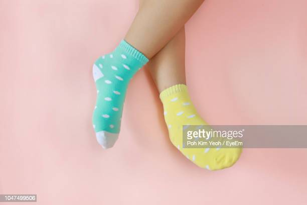 low section of woman wearing socks on colored background - ソックス ストックフォトと画像