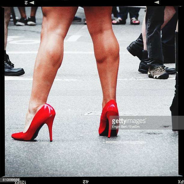 Low section of woman wearing Stiletto shoes