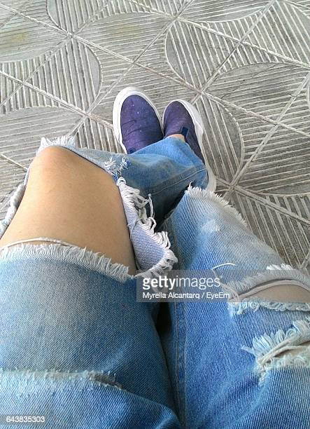 low section of woman wearing torn jeans on footpath - trail of tears stock photos and pictures