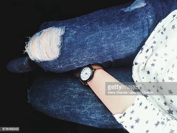 Low Section Of Woman Wearing Torn Jeans