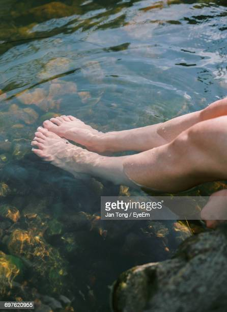 Low Section Of Woman With Ankle Deep In Lake