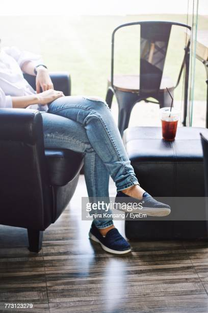 Low Section Of Woman With Drink Sitting At Restaurant