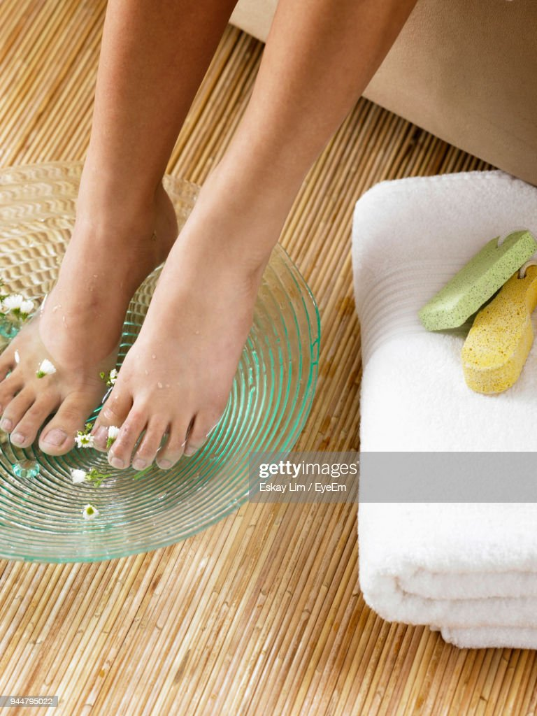 Low Section Of Woman With Feet In Water At Spa : Stock Photo