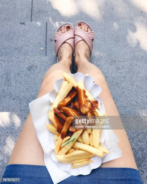 Low Section Of Woman With French Fries