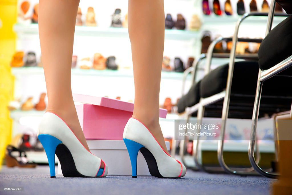 Low section of woman's legs in fashionable shoes : ストックフォト