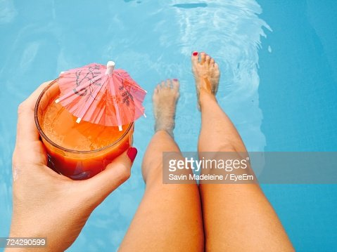 Low Section Of Womans Legs In Swimming Pool
