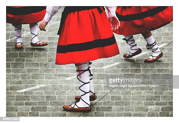 Low Section Of Women Dancing On Cobblestone