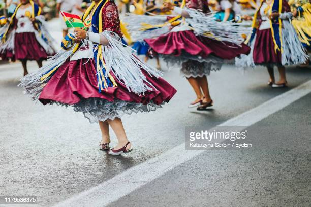 low section of women dancing on street in city - parade stock pictures, royalty-free photos & images