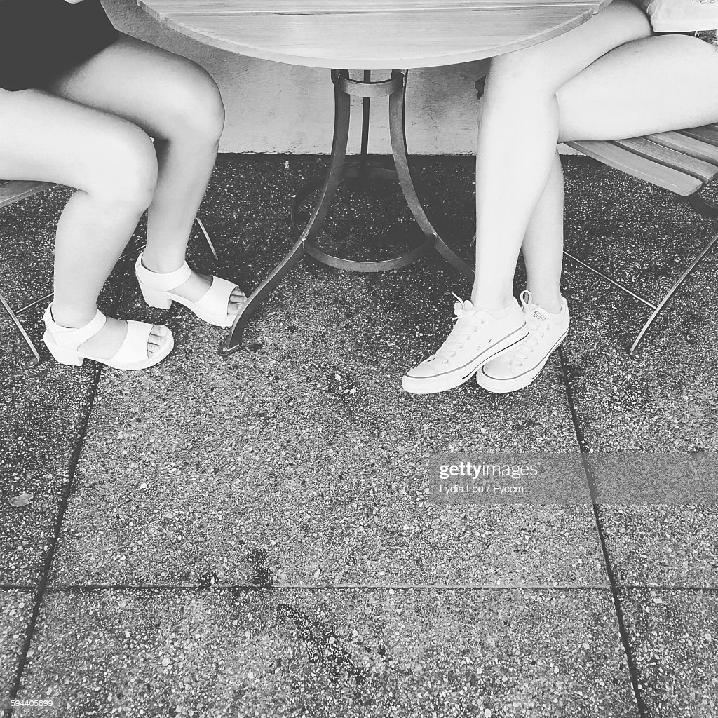 Low Section Of Women Sitting On Chair By Table At Sidewalk Cafe   Stock  Photo 1385ffe33d