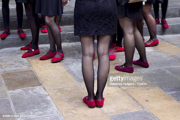 Low Section Of Women With Stockings Standing On Floor