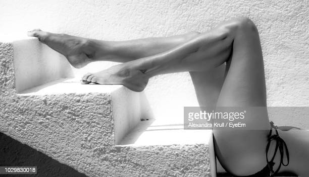 Low Section Of Young Woman Lying On Steps