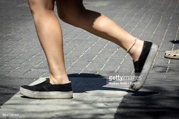 low section person walking on street - andres ruffo stock photos and pictures