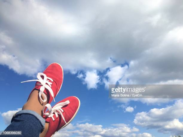low section person wearing shoes against sky - low section stock pictures, royalty-free photos & images