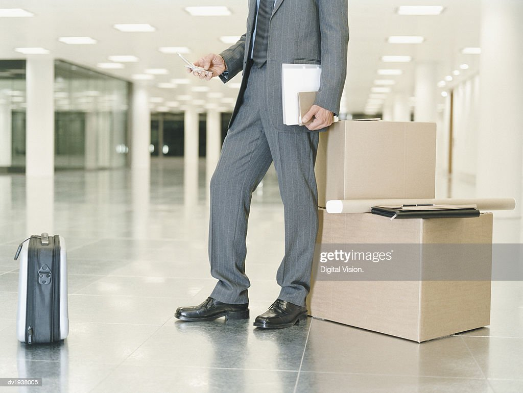 Low Section Shot of a Businessman Using a Mobile Phone : Stock Photo