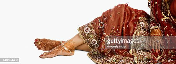 Low section view of a bride in traditional wedding dress