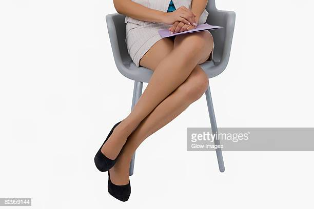 Low section view of a businesswoman waiting for interview