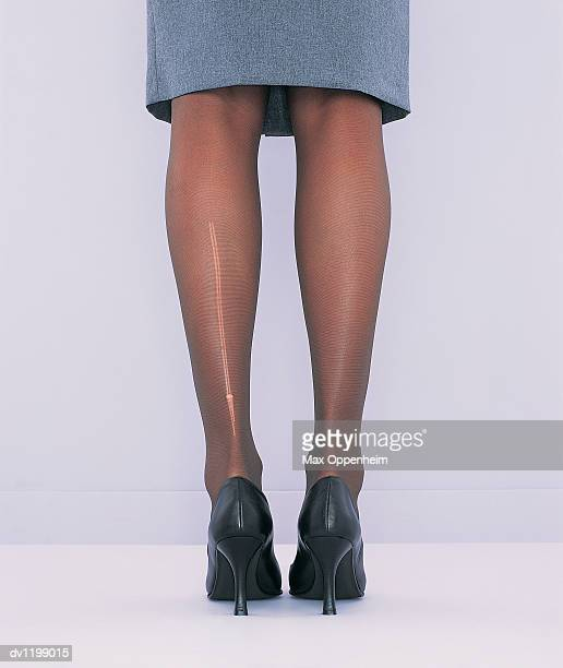 Low Section View of a Businesswoman's Torn Tights