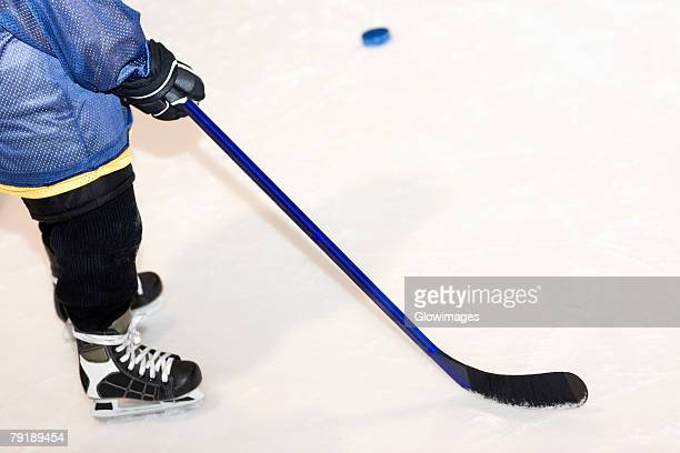 low section view of a man playing ice hockey - ice hockey uniform stock pictures, royalty-free photos & images