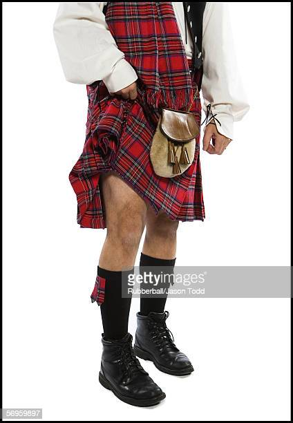 low section view of a man wearing a kilt - kilt stock photos and pictures